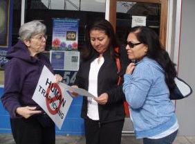 Sister Mary Judeen speaking to strangers on the street.