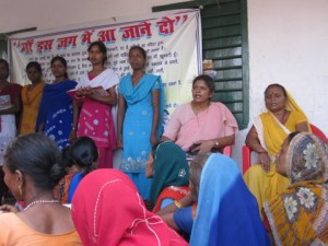Sr Nidhi with women and sign