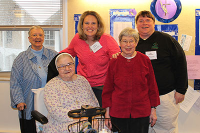 Current staff members of Cardinal Gibbons High School, Raleigh, North Carolina (back) Sr. Mary Jean Korejwo, Crista Anders, and Hal Sargent, meet with (front) former principal Sr. M. Teresita Gresko, and former teacher Sr. M. Lenette Marcello.
