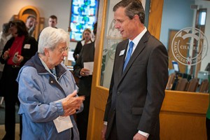 Sister Agnesmarie LoPorto, converses with Notre Dame College President Thomas Kruczek outside the chapel after the blessing ceremony.