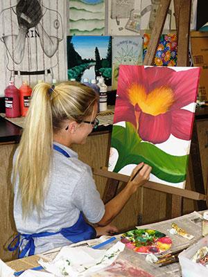 Art_Toledo:  IB Art student paints during class.