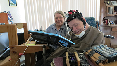 Sr. Mary Ruth's client uses adaptive headgear so he can use the computer in his apartment to send emails or play chess.